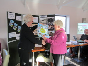The Mayor of Aberaeron, Mrs Owenna James, welcomes the new Town Photo Trail from Clare Thomas on behalf of Cymdeithas Aberaeron Society